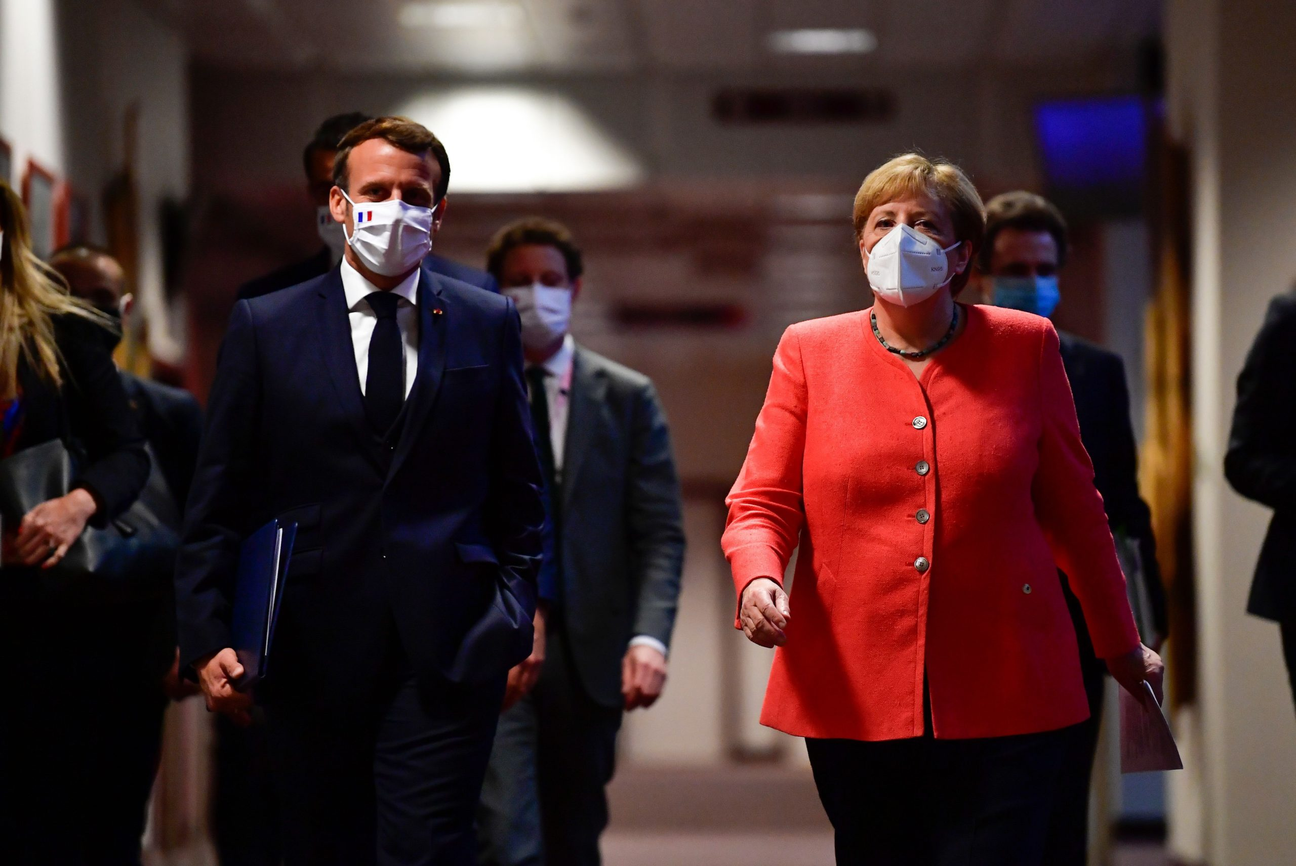 German Chancellor Angela Merkel (R) and French President Emmanuel Macron (L) arrive for a joint press conference at the end of the European summit at the EU headquarters in Brussels on July 21, 2020.  Photographer: John Thys/AFP/Getty Images