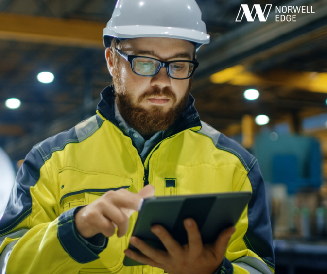 A worker using a tablet device.
