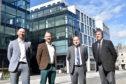From left, Neil Edward, Brian Archer, David Sinclair, and Michael Dursley, of Tech-Terra.