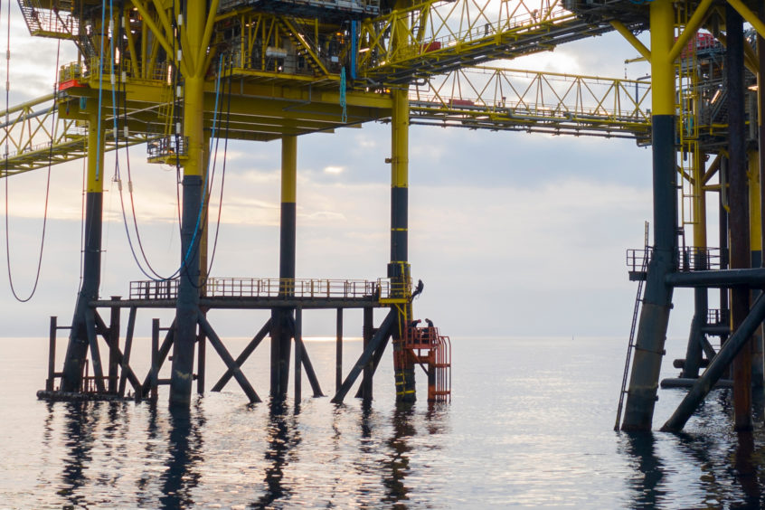 Four activists with Greenpeace are occupying the Dan Bravo oil rig. Photo  © Andrew McConnell / Greenpeace