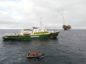 The Greenpeace Ship Esperanza passes in front of the Shell operated Oil platform Brent-C (Charlie). Photo by Carl Shanahan / Greenpeace