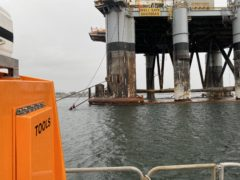 Pair 'stranded' on Cromarty Firth oil rig rescued by RNLI – video
