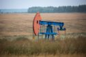"An oil pumping jack, also known as ""nodding donkey"", operates in an oilfield near Almetyevsk, Russia, on Sunday, Aug. 16, 2020. Oil fell below $42 a barrel in New York at the start of a week that will see OPEC+ gather to assess its supply deal as countries struggle to contain the virus that's hurt economies and fuel demand globally."