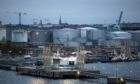 Fuel storage tankers sit on the dock at Vartahamnen harbour at the Port of Stockholm, Sweden, on Tuesday, Oct. 15, 2016. Oil tanker rates jumped to a four month high as traders booked the most cargoes for the time of year on record, offering signs that Middle East producers could be adding barrels to the market just before OPEC embarks on its deepest output cuts in eight years. Photographer: Andrey Rudakov/Bloomberg