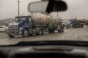 "Trucks leave the MarkWest Energy plant in Cadiz, Ohio, U.S., on Tuesday, Feb. 25, 2020. Many Rust Belt voters rely on oil and natural gas jobs and they're wary of Democratic proposals, such as the ""Green New Deal,"" that push for ""net-zero emissions"" and would effectively put coal and other fossil fuels out of business. Photographer: Justin Merriman/Bloomberg"