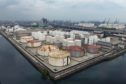 Fuel storage tanks stand at a PT Pertamina facility in this aerial photograph taken above Tanjung Priok Port in Jakarta, Indonesia on Tuesday, April 21, 2020.  Photographer: Dimas Ardian/Bloomberg
