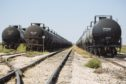 Tanker train cars sit parked near Sunray, Texas, U.S., on Saturday, Sept. 26, 2020. After all the trauma the U.S. oil industry has been through this year -- from production cuts to mass layoffs and a string of bankruptcies -- many producers say they're still prioritizing output over reducing debt. Photographer: Angus Mordant/Bloomberg