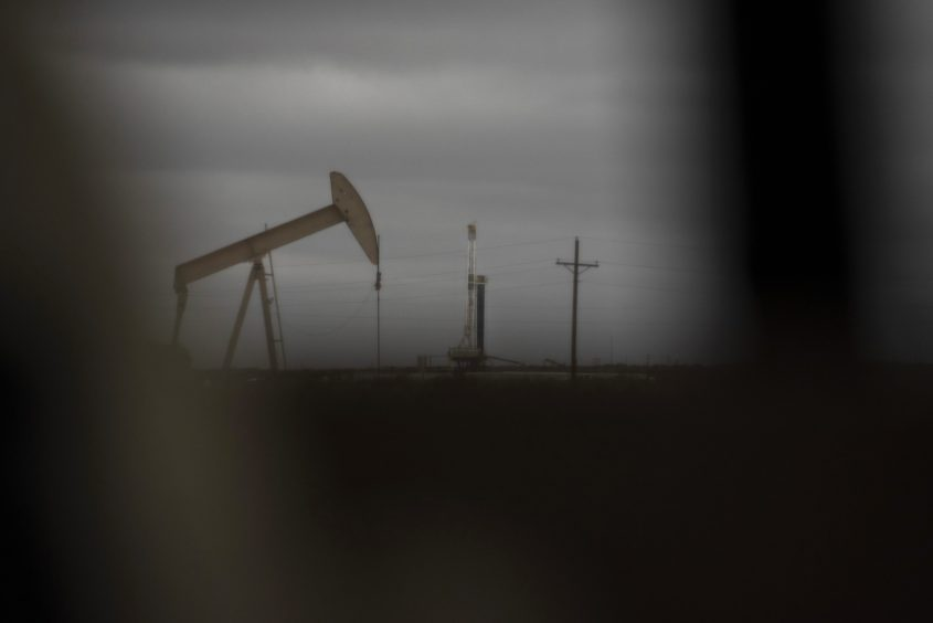 A horizontal drilling rig and a pump jack sit on federal land in Lea County, New Mexico, U.S., on Thursday, Sept. 10, 2020. With the U.S. oil industry reeling from the collapse in demand this year, the New Mexico shale patch has emerged as the go-to spot for drillers desperate to squeeze as much crude from the ground without bleeding cash. There's just one problem: Joe Biden wants to ban new fracking there.