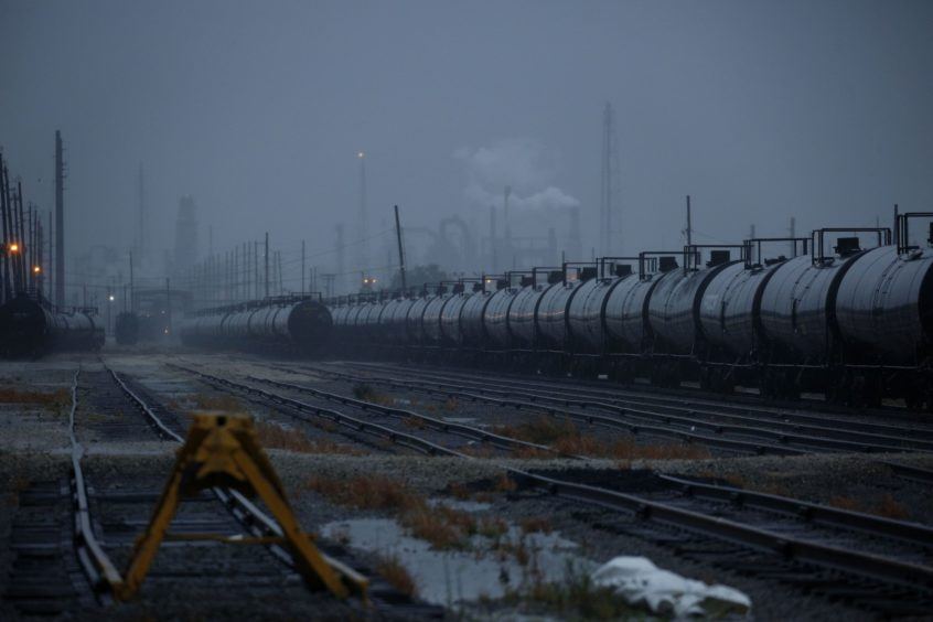 Oil tanker rail cars parked at the Motiva Port Arthur refinery ahead of Hurricane Delta in Port Arthur, Texas, U.S., on Friday, Oct. 9, 2020. Delta churned toward the U.S. Gulf Coast, packing a deadly storm surge and winds strong enough to damage well-built homes as it neared an area of Louisiana still recovering from Hurricane Laura. Photographer: Luke Sharrett/Bloomberg