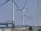 A vehicle drives past wind turbines operated by Wind Power Group KK in Kamisu, Ibaraki Prefecture, Japan, on Wednesday, April 29, 2020. Japan's industrial production fell less than expected in March but much steeper declines are likely ahead as a nationwide state of emergency shutters factories and keeps shoppers home to contain the coronavirus. Photographer: Toru Hanai/Bloomberg