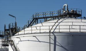 An oil storage tank stands at a facility in the Alrode district of Johannesburg, South Africa, on Tuesday, April 21, 2020. The oil meltdown accelerated, with huge losses sweeping through markets as the world runs out of places to store unwanted crude and grapples with negative pricing. Photographer: Waldo Swiegers/Bloomberg