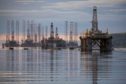 Mobile offshore drilling units stand in the Port of Cromarty Firth in Cromarty, U.K., on Tuesday, June 23, 2020. Oil headed for a weekly decline -- only the second since April -- as a surge in U.S. coronavirus cases clouded the demand outlook, though the pessimism was tempered by huge cuts to Russia's seaborne crude exports.