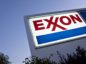 Signage is displayed at an Exxon Mobil Corp. gas station in Arlington, Virginia, U.S., on Wednesday, April 29, 2020. Exxon is scheduled to released earnings figures on May 1. Photographer: Andrew Harrer/Bloomberg