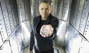 Dale Vince holding over GBP 1 million of Sky Diamonds, the world's first zero-impact diamond which are created using a sky mining facility to extract carbon from the atmosphere, with wind and sun providing the energy, as well as using rain water. Photo Jeff Moore/Borkowski/PA Wire