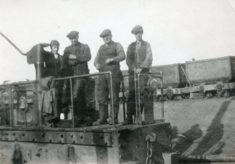 Workers on an electric locomotive circa 1902 between between Niddry Castle and the Duddingston Mines.