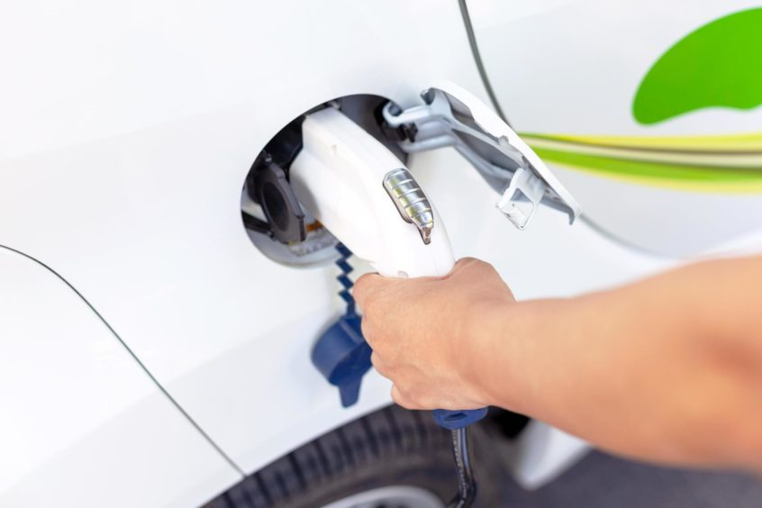 Electric car battery charging at charge station