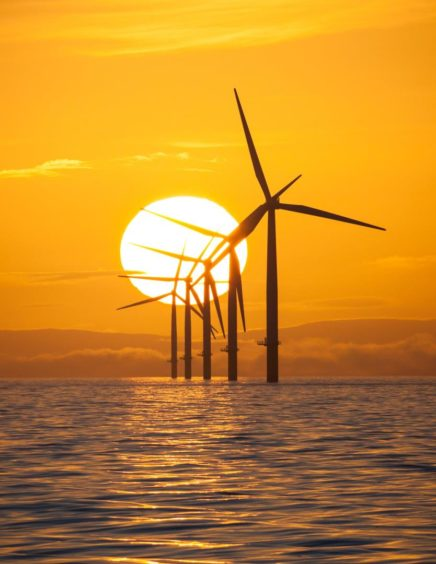 Mandatory Credit: Photo by Rob Arnold/Lnp/Shutterstock (9453121b) Irish Sea, UK.  The glowing sun rising over offshore wind turbines in the Irish Sea this morning. Seasonal weather, UK - 09 Mar 2018 The North West of England is set to experience clear and sunny weather.
