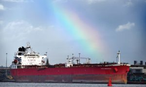 A rainbow over the Nave Andromeda at berth in Port of Southampton this morning, following the major incident off the east coast of the Isle of Wight after 7 stowaways were detained from the vessel after a reported hijacking. Photo by Simon Czapp/Solent News/Shutterstock