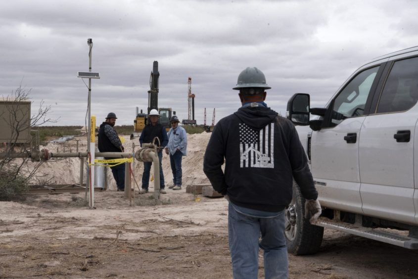 Workers with S&J Contractors lay a pipeline in Lea County, New Mexico, U.S., on Thursday, Sept. 10, 2020. With the U.S. oil industry reeling from the collapse in demand this year, the New Mexico shale patch has emerged as the go-to spot for drillers desperate to squeeze as much crude from the ground without bleeding cash. There's just one