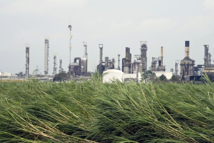 A Motiva Enterprises LLC oil refinery sits idle in shutdown mode after losing power during Hurricane Gustav in Convent, Louisiana, U.S., on Tuesday, Sept. 2, 2008. Motiva Enterprises LLC, the U.S. refining venture of Royal Dutch Shell Plc and Saudi Aramco, said damage to the plant's electrical system may delay the restart by more than a week. Photographer: F. CARTER SMITH/Bloomberg News