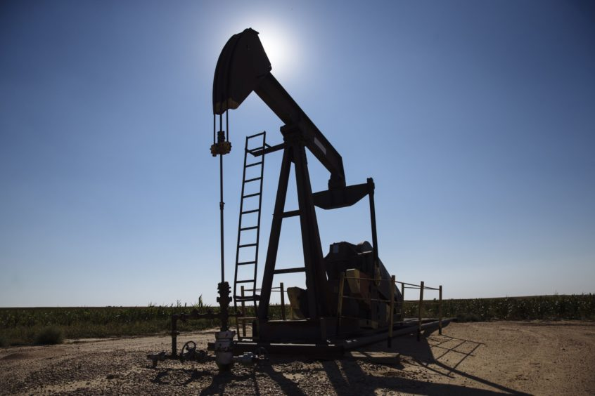 A pump jack operates near Hugoton, Kansas, U.S., on Friday, Sept. 25, 2020. After all the trauma the U.S. oil industry has been through this year -- from production cuts to mass layoffs and a string of bankruptcies -- many producers say they're still prioritizing output over reducing debt.