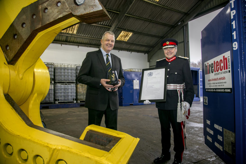 Andy Buchan, CEO, Hiretech Limited (left) receives the Queen's Award for Enterprise from Her Majesty The Queen's Lord-Lieutenant of Aberdeenshire, Sandy Manson (right).