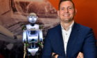 Arne Gürtner of Equinor with the RoboThespian humanoid at Aberdeen Science Centre. Picture by Kami Thomson