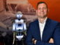 Arne Gürtner of Equinor with the RoboThespian humanoid. Picture by Kami Thomson