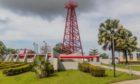 The Grand Old Lady oil well in Miri, Sarawak, Malaysia; Shutterstock.