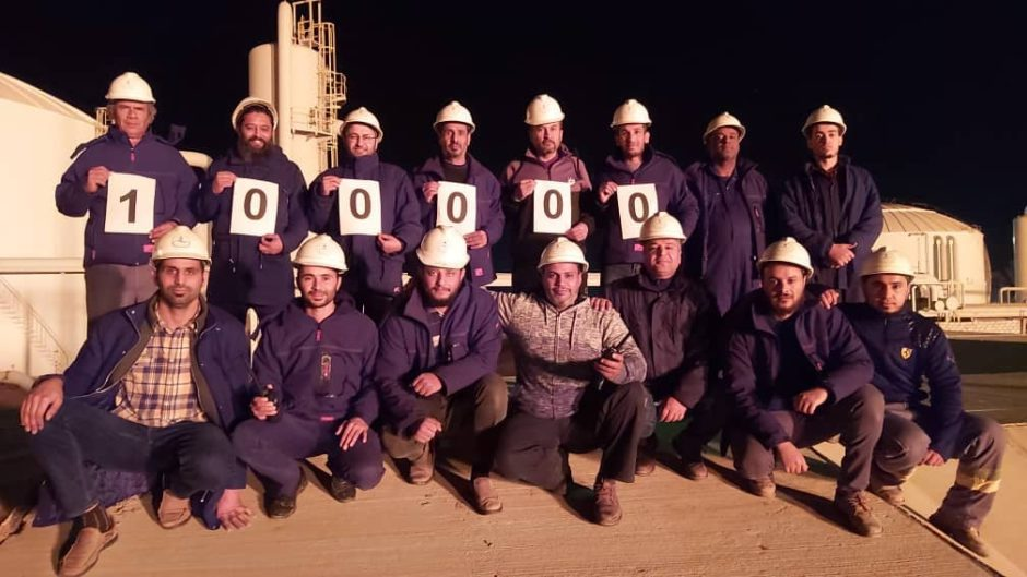 Sirte Oil Co. employees celebrate reaching 100,000 bpd on December 17, 2020