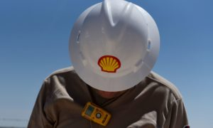 A logo is displayed on the hardhat of a worker at the Royal Dutch Shell Plc processing facility in Loving, Texas, U.S., on Friday, Aug. 24, 2018.
