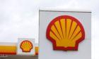 Shell logo against overcast sky