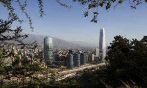 Buildings stand in the skyline of downtown Santiago, Chile, on Wednesday, Dec. 3, 2014.  Photographer: Ronald Patrick/Bloomberg