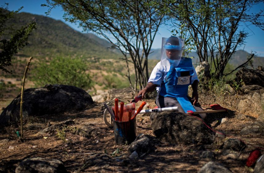 KANENGUERERE, ANGOLA - HALO deminer Beatriz Chawayaca checks her lane for anti-personnel mines in Kanenguerere.  The area was mined during the civil war by government forces to protect the nearby railway line, as well as various troop positions.