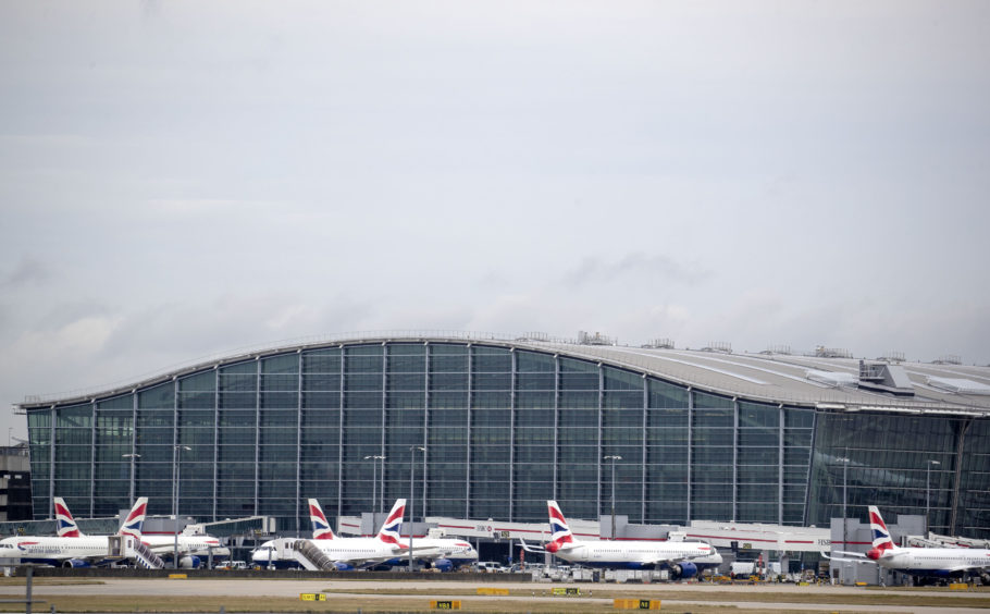 British Airways planes at Terminal Five at Heathrow Airport, London. PA Wire