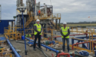 Sachin Oza and Stephen Williams, co-CEOs of Reabold Resources, at the rig at West Newton, during the drilling of B-1.