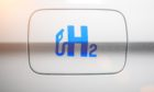 Car with hydrogen logo on filler cap. h2 combustion engine for emission free ecofriendly transport.; Shutterstock ID 1631202373; Purchase Order: EV supplement; Job: Cresswell oped; 9032496e-6cef-4577-b30d-309c8ee85631