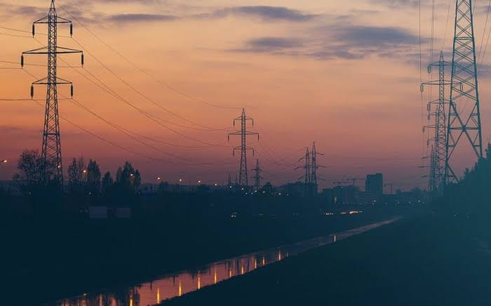 Power lines against a sunset