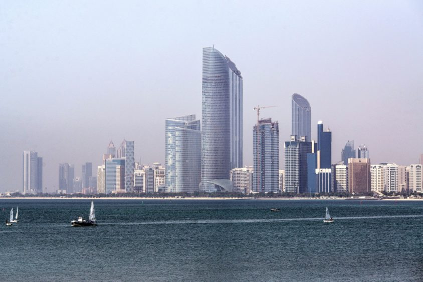 The Landmark skyscraper, center, stands on the city skyline beside a waterway in Abu Dhabi, United Arab Emirates, on Monday, May 30, 2016.  Photographer: Alex Atack/Bloomberg