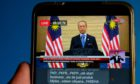 A live news broadcast of Malaysia's Prime Minister Muhyiddin Yassin, is arranged on a smartphone in Shah Alam, Selangor, Malaysia, on Tuesday, Jan. 12, 2021.