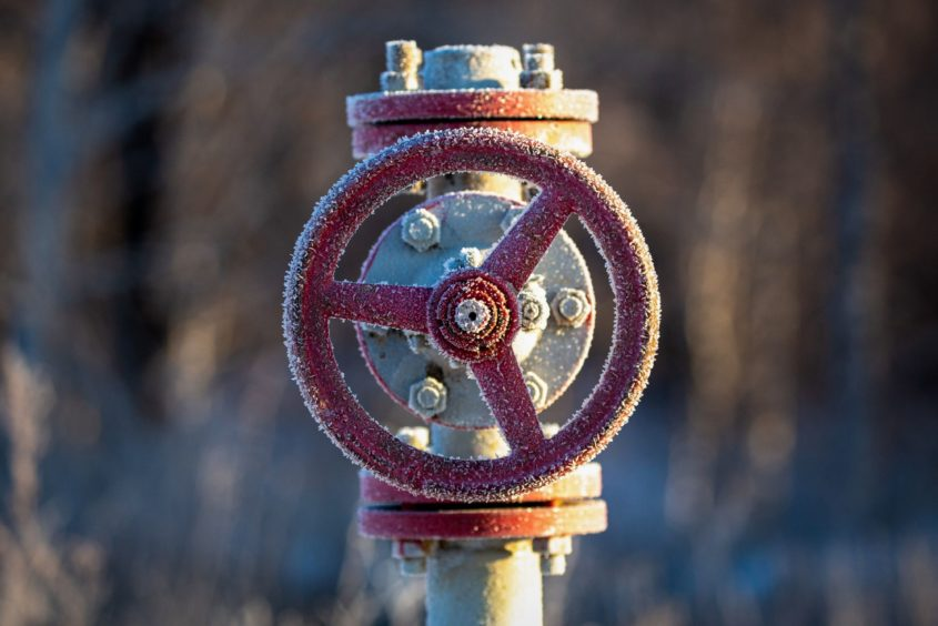 A valve control wheel connected to crude oil pipework in an oilfield near Dyurtyuli, in the Republic of Bashkortostan, Russia, on Thursday, Nov. 19, 2020.