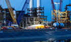 Fluor plans to sell off its Stork unit with the next 12-18 months, amid a shift to more reimbursable work.