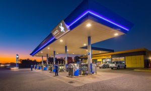 A petrol station lit up at night