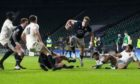 Duhan van der Merwe of Scotland breaks a tackle to score a try during the Rugby Six Nations match between England and Scotland in Twickenham. Supplied by FACUNDO ARRIZABALAGA/EPA-EFE/Shutterstock