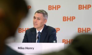 Mike Henry, incoming chief executive officer of BHP Group Ltd., listens during a news conference at the company's headquarters in Melbourne, Australia, on Thursday, Nov. 14, 2019. BHP named Henry, the head of its Australian operations, as chief executive officer to steer the world's top miner through looming challenges from slower growth in China and investor pressure over climate change. Photographer: Carla Gottgens/Bloomberg