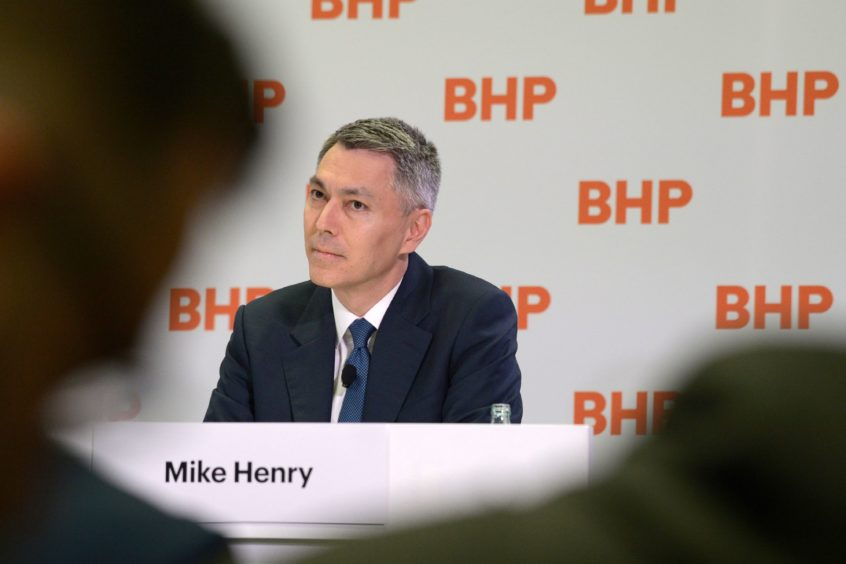 Mike Henry, incoming chief executive officer of BHP Group Ltd., listens during a news conference at the company's headquarters in Melbourne, Australia, on Thursday, Nov. 14, 2019. BHPnamedHenry, the head of its Australian operations, as chief executive officer to steer the world's top miner through looming challenges from slower growth in China and investor pressure over climate change. Photographer: Carla Gottgens/Bloomberg