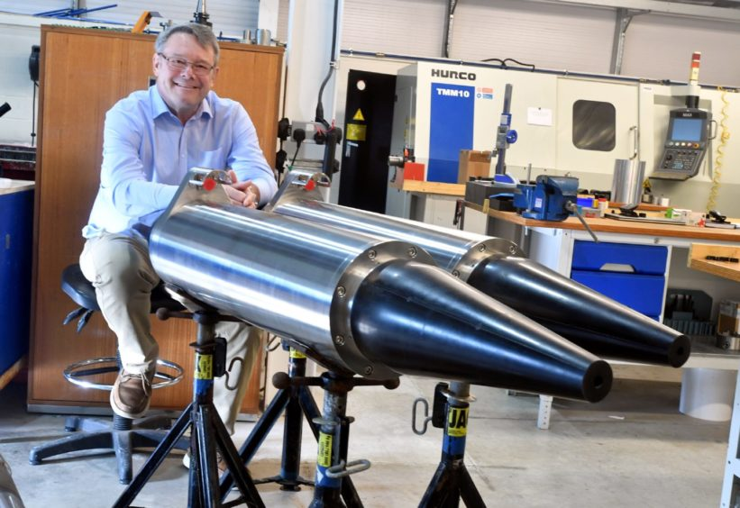 OceanTools managing director Kevin Parker with the firm's housings.
