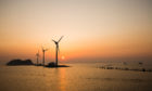 Daebu Island, Ansan-si, Gyeonggi-do, Korea - March 8, 2020: Sunset view of the sea with tourists and wind power plants