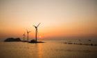 Daebu Island, Ansan-si, Gyeonggi-do, Korea - March 8, 2020: Sunset view of the sea with tourists and wind power plants