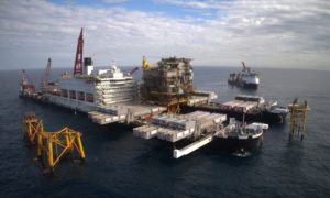 Pioneering Spirit transporting topsides from the Tyra field in the Danish North Sea.